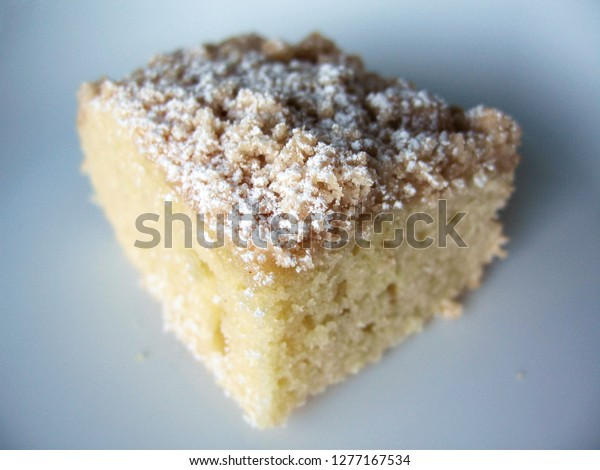 Delicious coffee cake square sitting on white plate