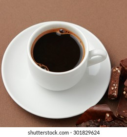 Delicious coffee cup and chocolate bar