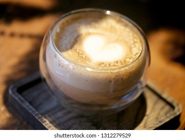 Delicious coffee with a heart in a glass take a close-up picture