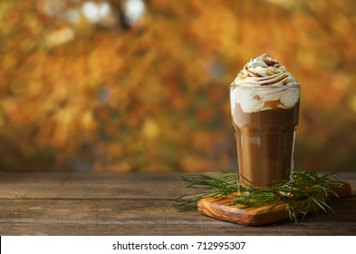 Delicious coffee on autumn background