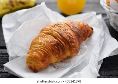 Delicious continental breakfast with fresh flaky croissants, ass