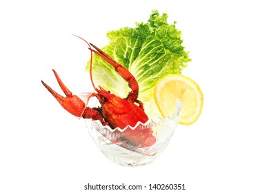 Delicious cooked crayfishes served with green salad leaves isolated on white background