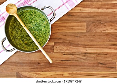 Delicious cooked creamed spinach in a pot - delicious spinach as a healthy meal for lunch, freshly prepared and ready to eat