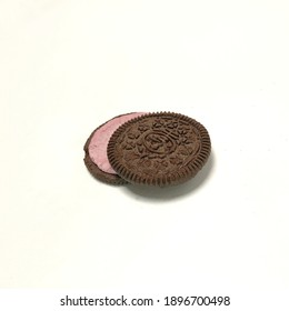 A delicious cookie consisting of two chocolate wafers with a sweet blueberry cream filling in between