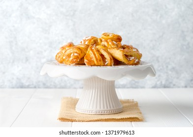 Delicious cookies on delicate white wooden background