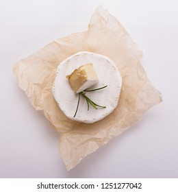 delicious creamy camembert cheese on a white background