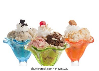 Delicious and creamy ice cream sundae; isolated on a white background
