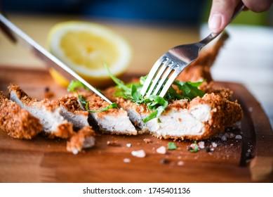delicious crispy panko pork schnitzel with wedges & fresh pepper