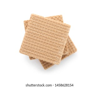 Delicious crispy wafers on white background, top view. Sweet food