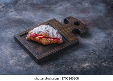 Delicious croissant with strawberry for breakfast, copy space