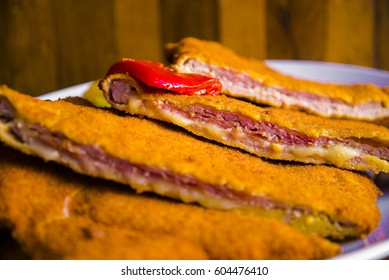 Delicious crunchy breaded steak with cheese - Spanish cachopo