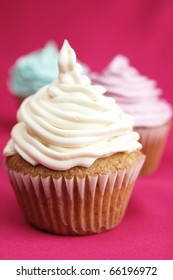 Delicious cup cake with three different colors.  White, blue and pink