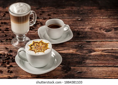 Delicious Cup of hot cappucino is on the wooden table. It is an art on the latte
