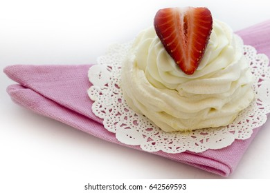 Delicious cupcake with ripe berries. A piece of strawberry