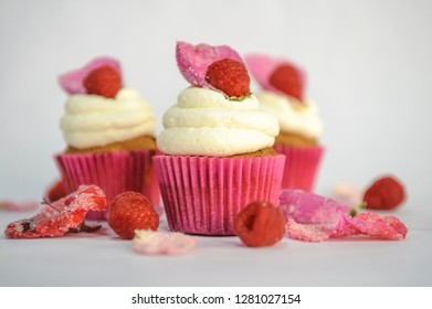 Delicious cupcakes with berries, close up