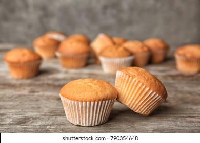 Delicious cupcakes on table, closeup