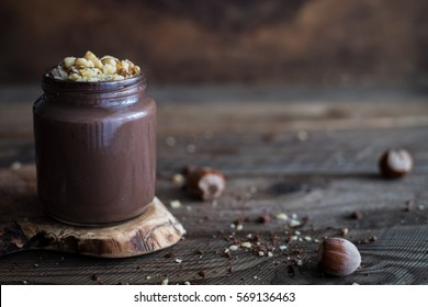 Delicious dark chocolate mousse or cream with chopped hazelnuts and walnuts