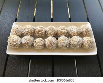 Delicious dessert - coconut and nut balls
