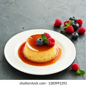 delicious dessert creme brulee with berries.