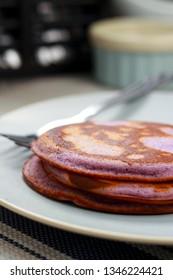 Delicious dessert. Pancakes with purple jam. Ube Pancakes.