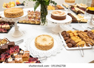 Delicious dessert table with various pastries, coffee and nut cakes catering idea