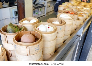 Delicious Dimsum , It's the appetizer  food with coffee or tea in bamboo tray. Dimsum is cooked by steam and eat with sauce. This is very good taste of Chinese food styles.