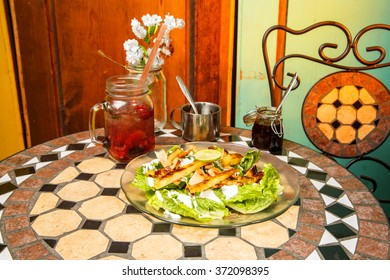 Delicious dish of chicken with salad and fruit drink
