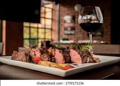 Delicious dish made from beef served with a glass of wine