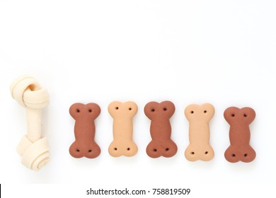 Delicious of dog biscuits , dog snack or dog  chew copy space on the white background, Can use background for web or product design and Advertising for pet food, etc.