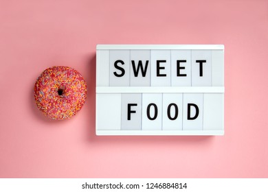 Delicious Donut on pink Background