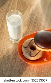 Delicious donuts with cup of milk