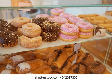 Delicious donuts on store shelves closeup