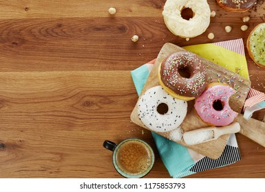 Delicious donuts on wood