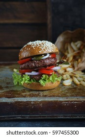 Delicious double burger with french fries on a dark background, Atmospheric restaurant, Food photography