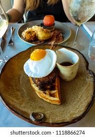 Delicious duck and waffle served with a duck egg
