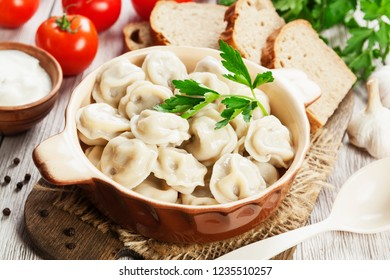 Delicious dumplings in the pot on the table