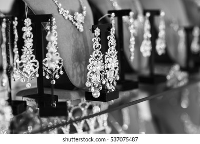Delicious earrings for bride on dark background. Wedding details