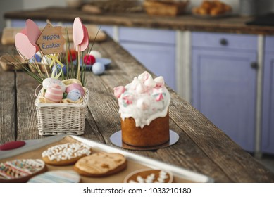 Delicious easter bakery standing on the table in the cuisine. Focus on eggs and sweet bread. Copy space in right side