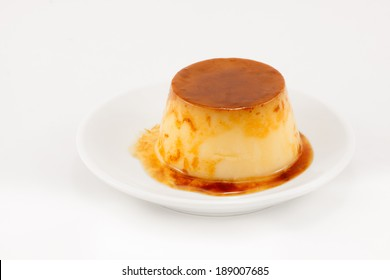 Delicious egg baked caramel flan liquid isolated on white background