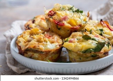 Delicious egg muffins with ham, cheese and vegetables
