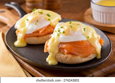 A delicious eggs benedict with smoked salmon, hollandaise sauce, and chives.