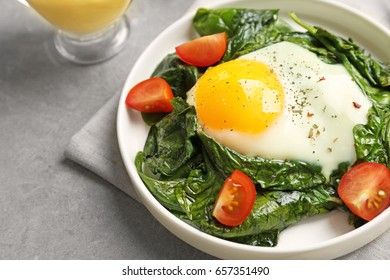 Delicious eggs Florentine with tomatoes, close up