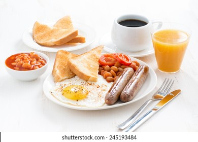 delicious English breakfast with sausages, horizontal