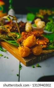 Delicious Filipino sisig variety street food shot in studio