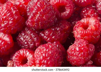 Delicious first class fresh raspberries background