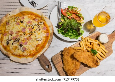 delicious fish and chips, ham pizza and spicy salmon salad
