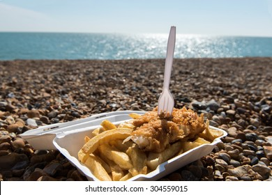 Delicious fish and Chips take away meal enjoyed on the beach