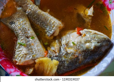 Delicious fish soup with onion tomato chillies sauce herbs pineapple traditional Vietnamese food