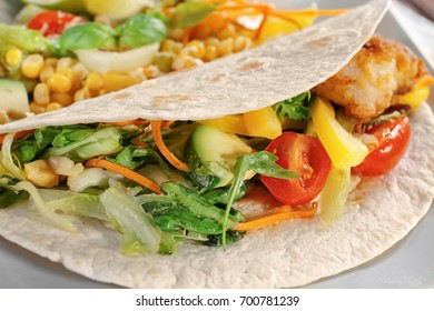 Delicious fish taco with filling, close up