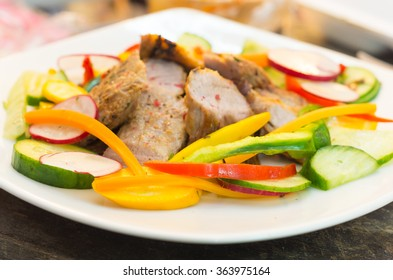 Delicious flank steak cuts cooked to perfection, mixed with reddish, zucchini and capsicum, elegant presentation